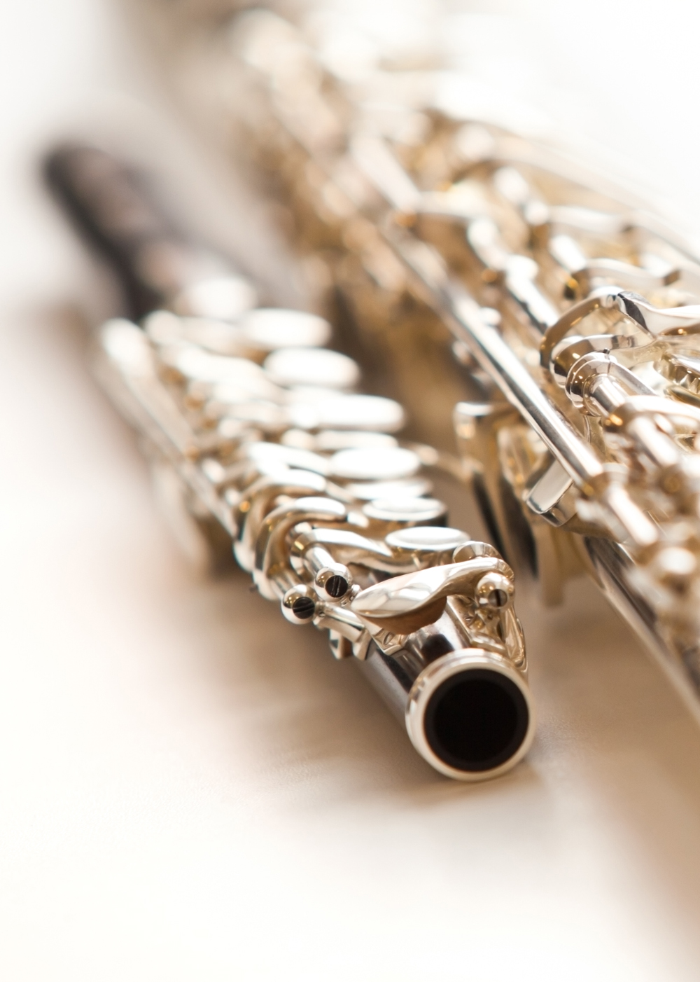 Two flute closeup lying on a light background